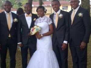 COUPLE WITH GROOM'S MEN