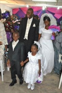 VICTOR & JENNIFER UYANWANNE WITH LITTLE GROOM & LITTLE BRIDE WALKING IN