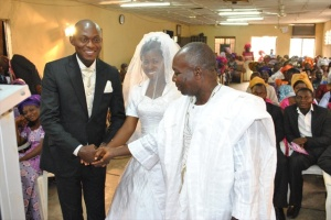 VICTOR UYANWANNE RECEIVING THE BRIDE FROM HER DAD